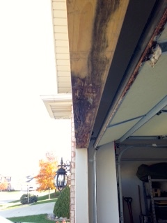Rotted garage door header in bloomington il water damage repair