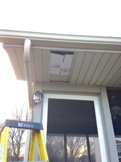Missing Soffit Panel is blocked by Carboard to keep birds from nesting
