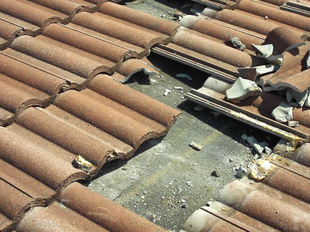 broken roof clay tiles