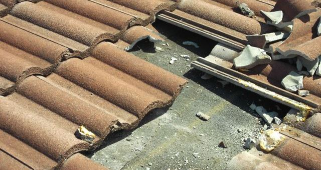 broken roof clay tiles