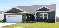 Ironstone dark grey shakes and siding with white trim and CertainTeed Moire Black roof in Mahomet IL