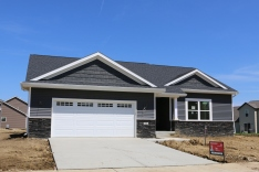Dark grey siding and shakes (Ironstone), white trim, Black roof in Mahomet IL