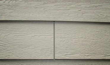 gap between two siding panels to allow for expansion and contraction