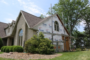 In process shot of a reside and window replacement on bloomington IL home. Carlson Exteriors crews keeps our job sites very clean.