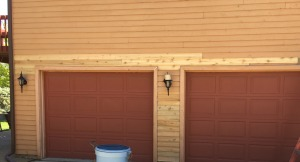 Cedar Siding panel replacement around garge in Bloomington IL