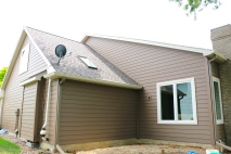 Royal Celect Siding in Chestnut brown with Willow (off white or cream) Trim