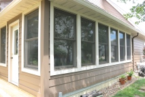 Royal Celect Window casings in Willow (off white or cream trim) and Chestnut brown siding in bloomington il
