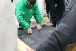 Rolling out rubber roof