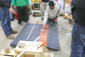 Carlson Exteriors Inc crew member applies adhesive