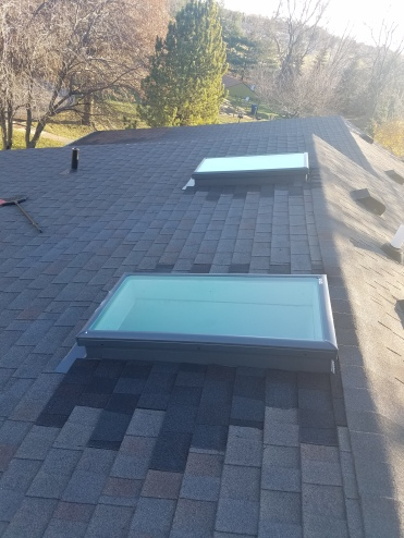 New Skylights with shingles installed to match as best as possible