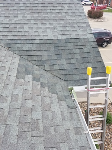After - Roof was repaired after a large hole was put through the roof by a tree