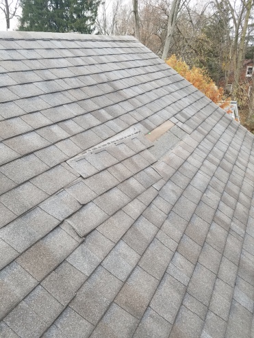Before - Shingles are loose and missing from a storm in Bloomington IL