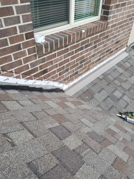 New flashing is being installed on a home in Bloomington il