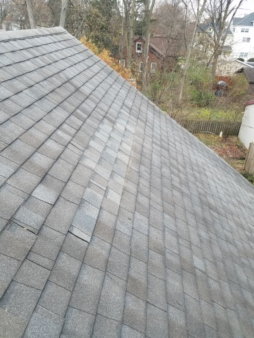 After - Old shingles were loose and missing. New shingles were installed as best matching color in bloomington il
