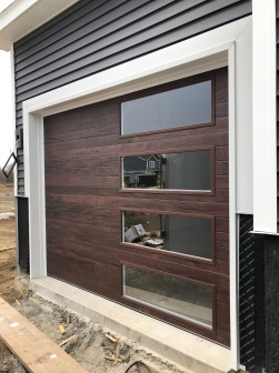 Fake mahogany garage door with glass on one side edwards il