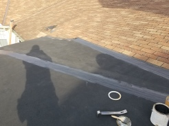 Seams were repaired on this low slope roof with EPDM flashing tape and sealant