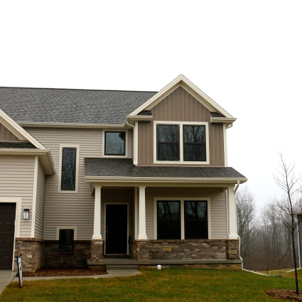 Rugged canyon brown vertical siding, desert sand horizontal siding, cameo trim, weathered wood asphalt shingles in downs, il
