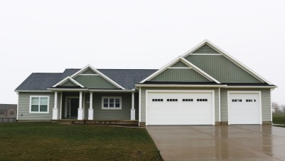 Scottish Thistle light green siding shakes white trim and black roof downs il