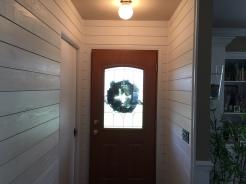 Shiplap wall with detailed trim work around door ways in Danvers IL