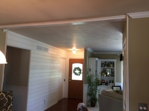 Shiplap entryway makes for a stunning entrance into your home. White shiplap walls in Danvers il