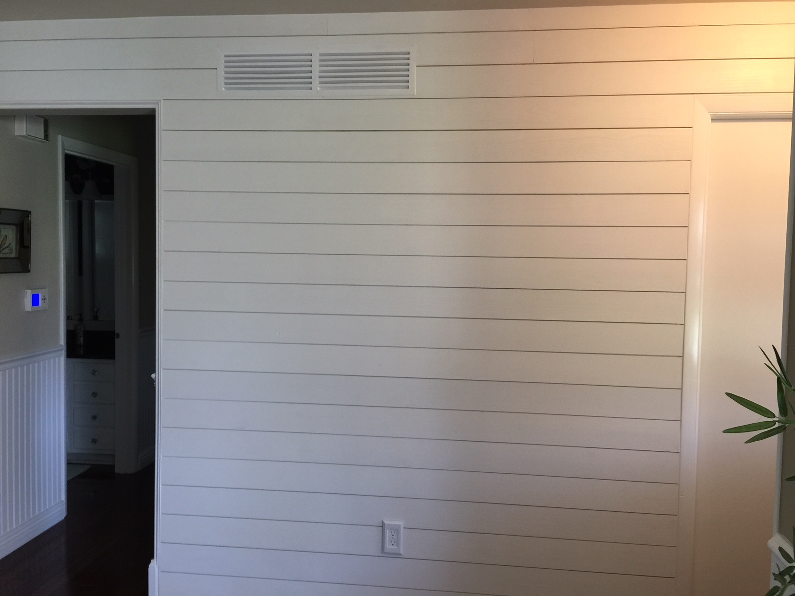 Side View Of Shiplap Wall Install In Carlson Exteriors