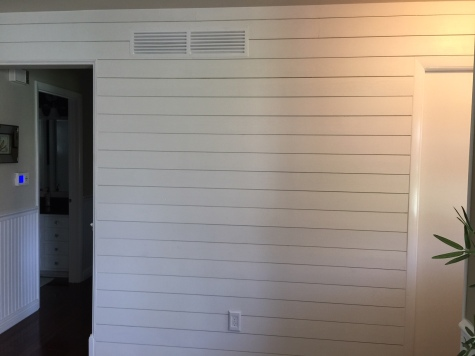 Shiplap wall with detailed trim work around door ways in Danvers IL