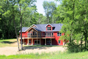 Mastic Russet red vertical siding, white trim, natural clay shake siding, certainteed moire black shingles in canton il